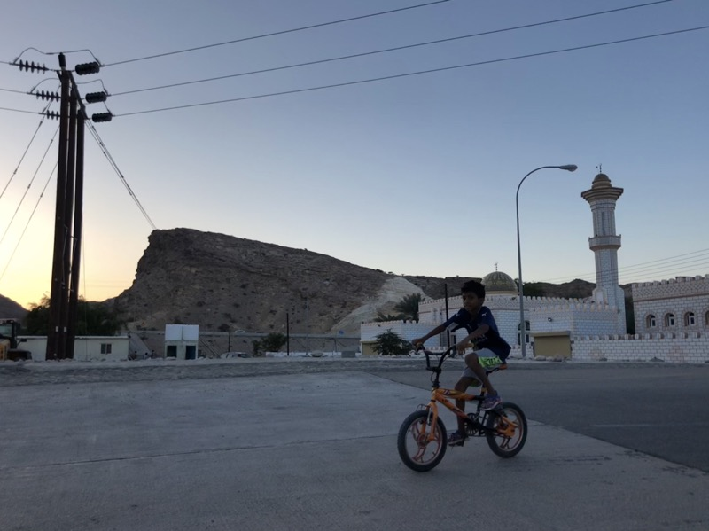 Awesome pic of boy riding a bicycle somewhere in Oman.