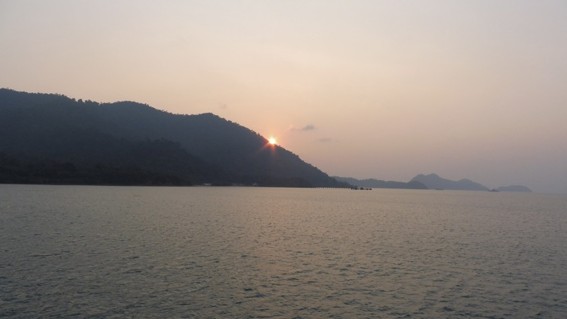 The sun is on the edge into another night in Koh Chang, Thailand.