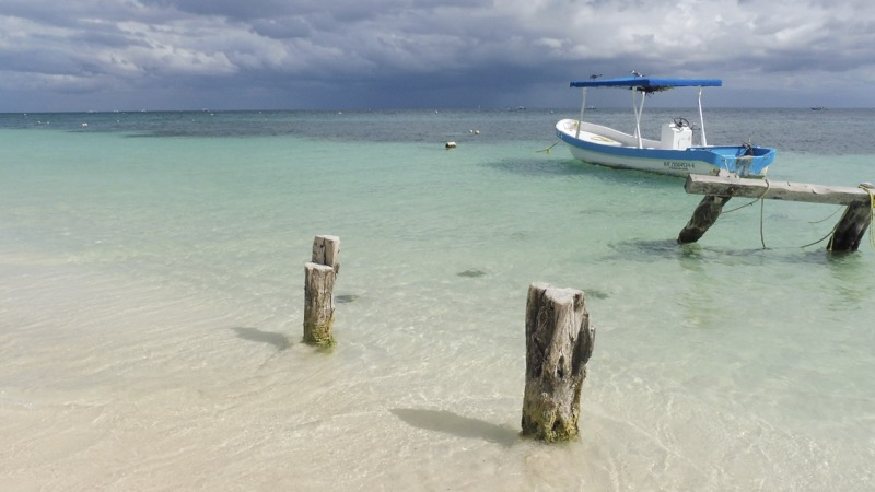 A boat at the beach of Puerto Morelos