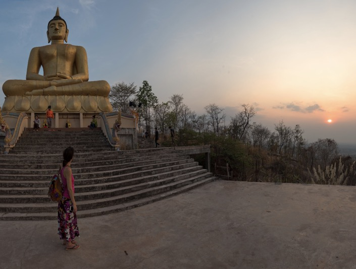Sunset, the Big Golden Buddha and Irene in Pakse, Laos