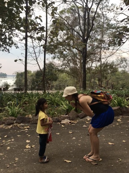 Irene greeting a local child in Laos