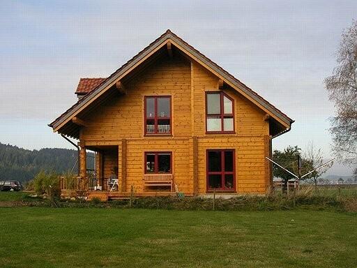 Holzhaus in Blockbauweise - Massivholzhaus Ebersburg in zwei Ebenen