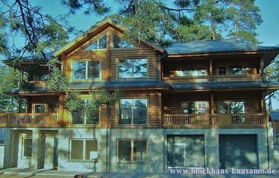 Rundbohlenhaus - Rustikales Holzhaus in Rundblockbauweise - Blockhaus bauen