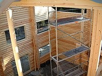 Rundbohlenhaus - Blockhaus bauen -  Rohbau - Ausbau