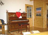 Musikzimmer im Blockhaus als Wohnhaus - Einfamilienhaus
