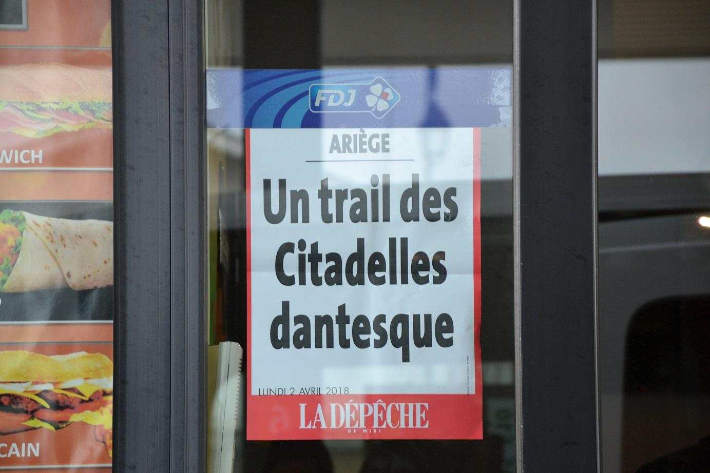 92-En route, on découvre la Une du journal local..