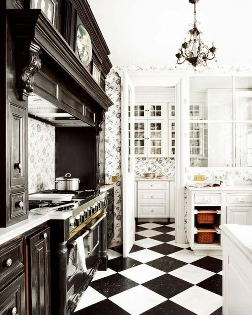 Black kitchen with chess tile floor.