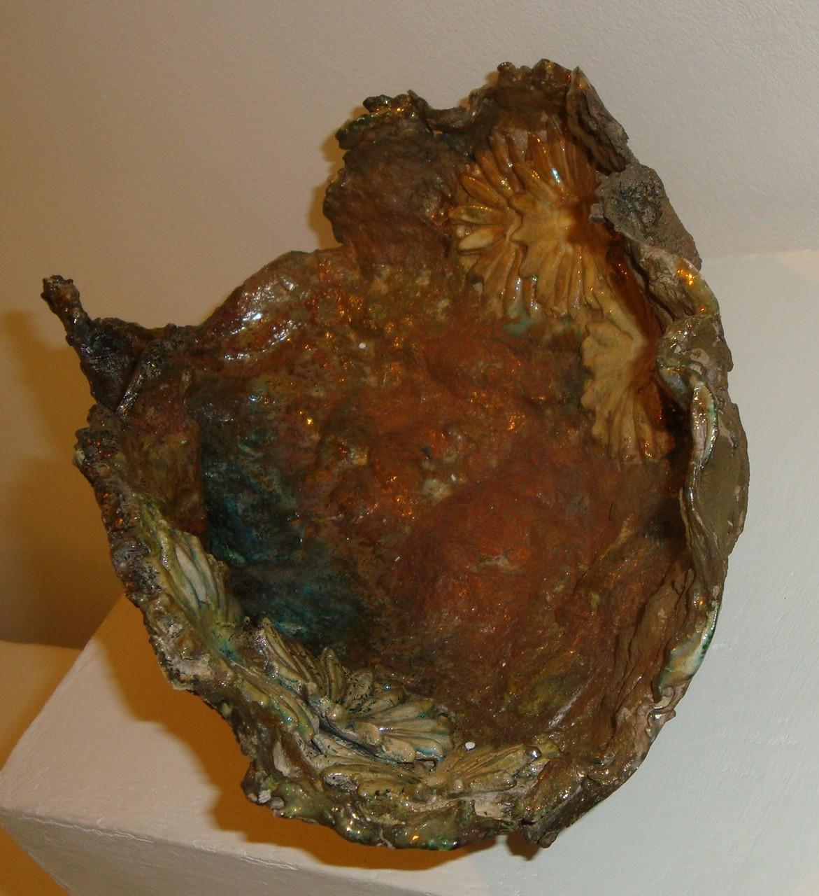 paper clay biscottata a 1200° e successivamente cotta con metodo raku a 1050°
