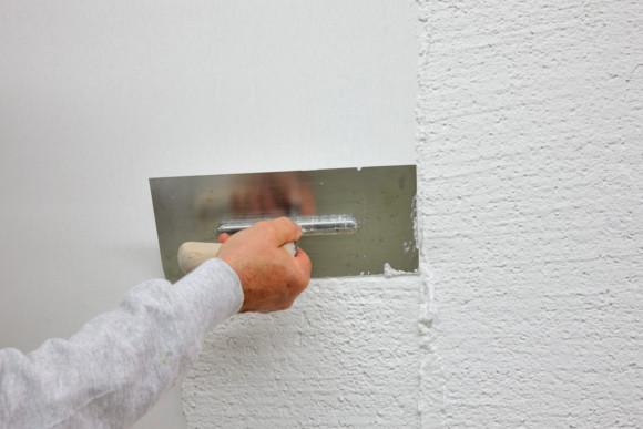 Verspachteln einer Fassade