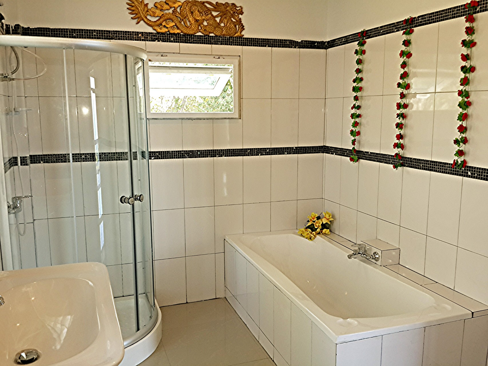 bathroom wit shower and tub