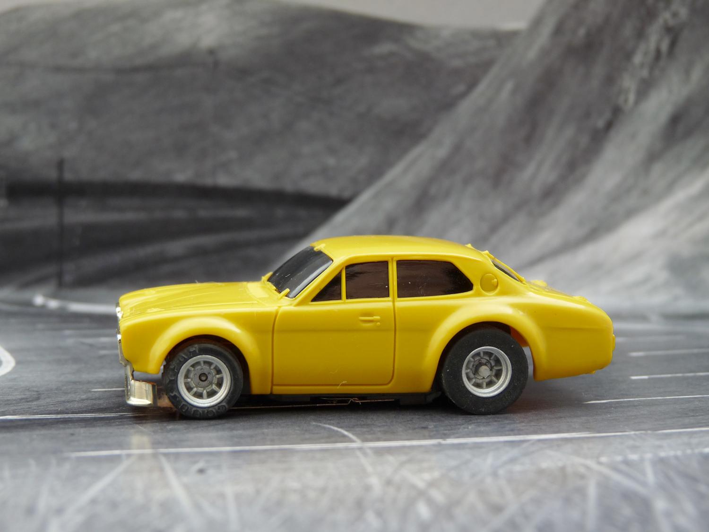 AURORA AFX Ford Escort gelb goldene Stoßstange