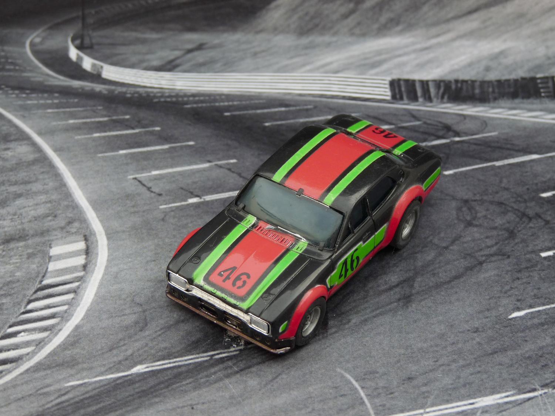 AURORA AFX Ford Escort schwarz/rot/grün #46