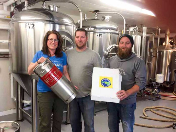Andrea Charlton and Eric Labelle of Split Rail Brewery flank Richard Anger of Manitoulin Pizza Company. The two companies have partnered this summer to offer patrons two of the most loved things in the same convenient spot––pizza and beer.