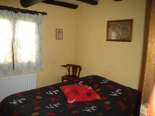 The small bedroom. A bedroom with a double bed