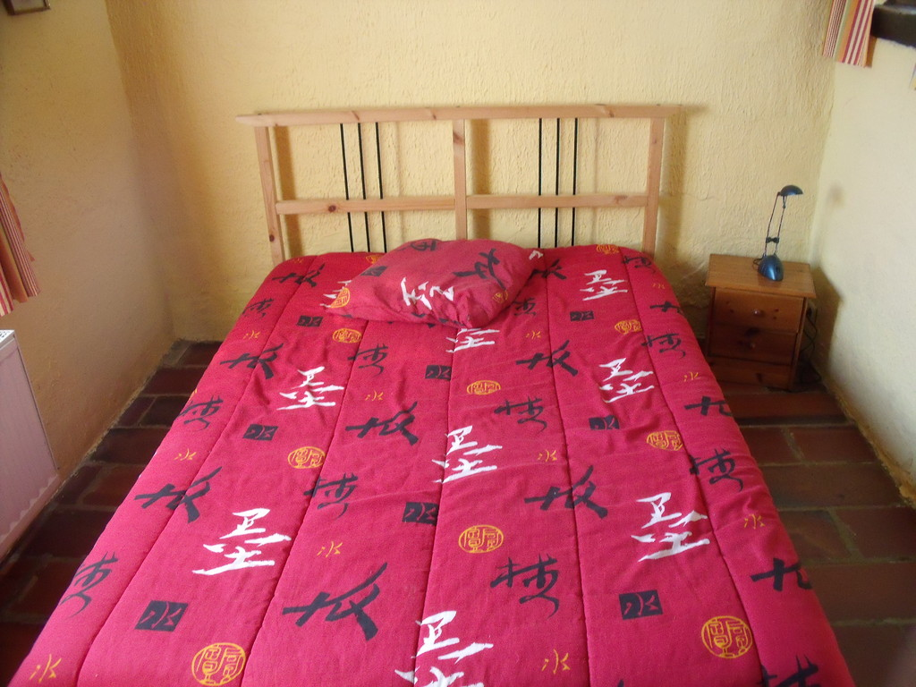 La petite chambre Une chambre avec un lit deux personnes