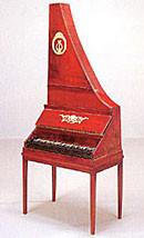 赤い縦型ピアノ