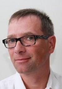 Dr. Roman Husz