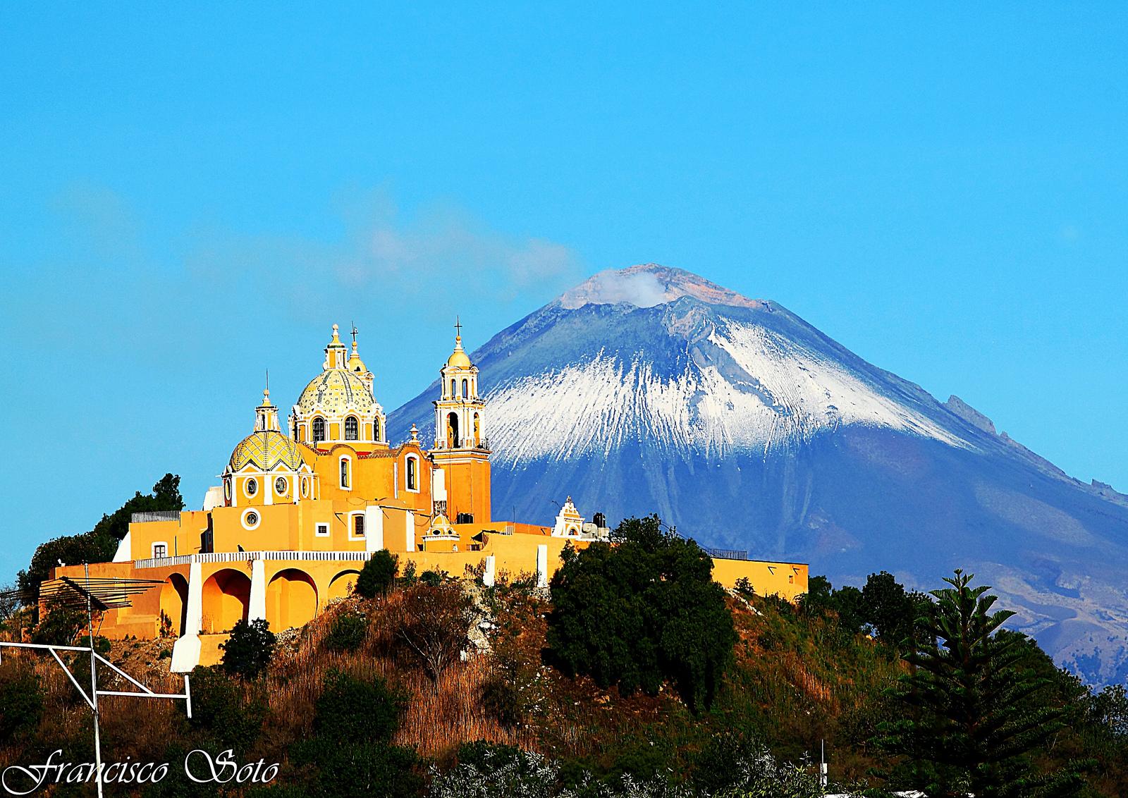 Cholula: El Popocatépetl and the church of La Señora de los Remedios, built on top of the largest pyramid in Mexico*