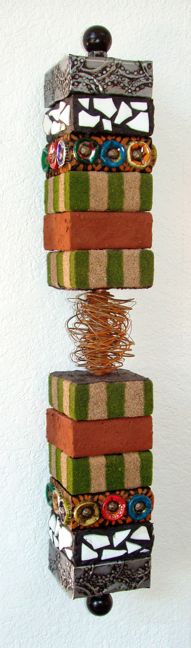 """Contained Chaos: 4"""" x 25"""" x 4"""" mixed media"""