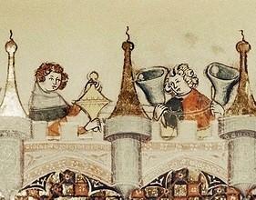 A medieval handbell ringer (right)