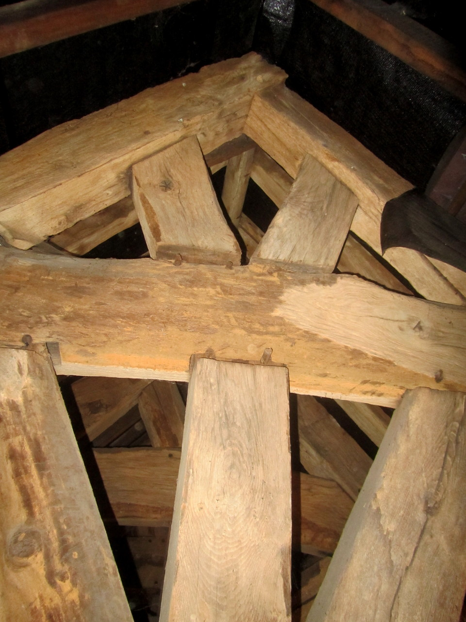 Extra strenghtening on the beams show where a bellcote was in the Middle Ages.