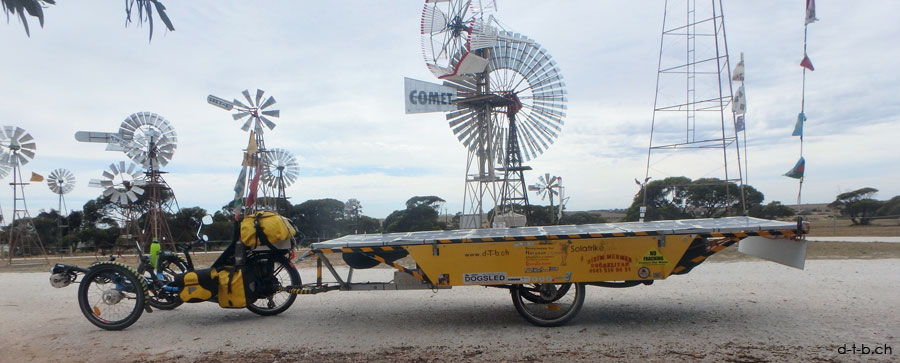 AU: Solatrike in Penong with Wind turbines