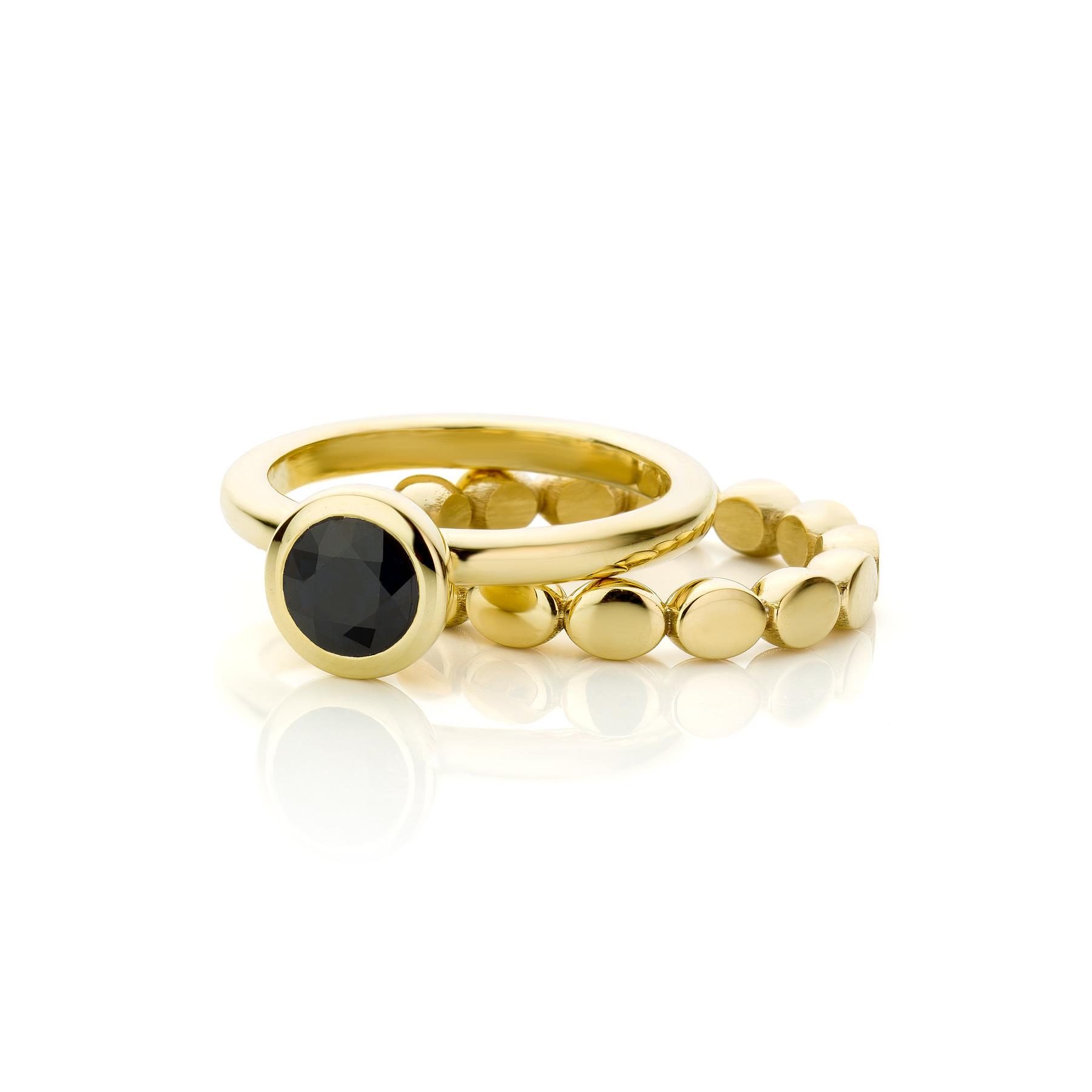 Gouden ring met saffier & ovalen zijring