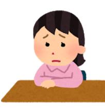 席に座って悲しい顔をしている女の子の図