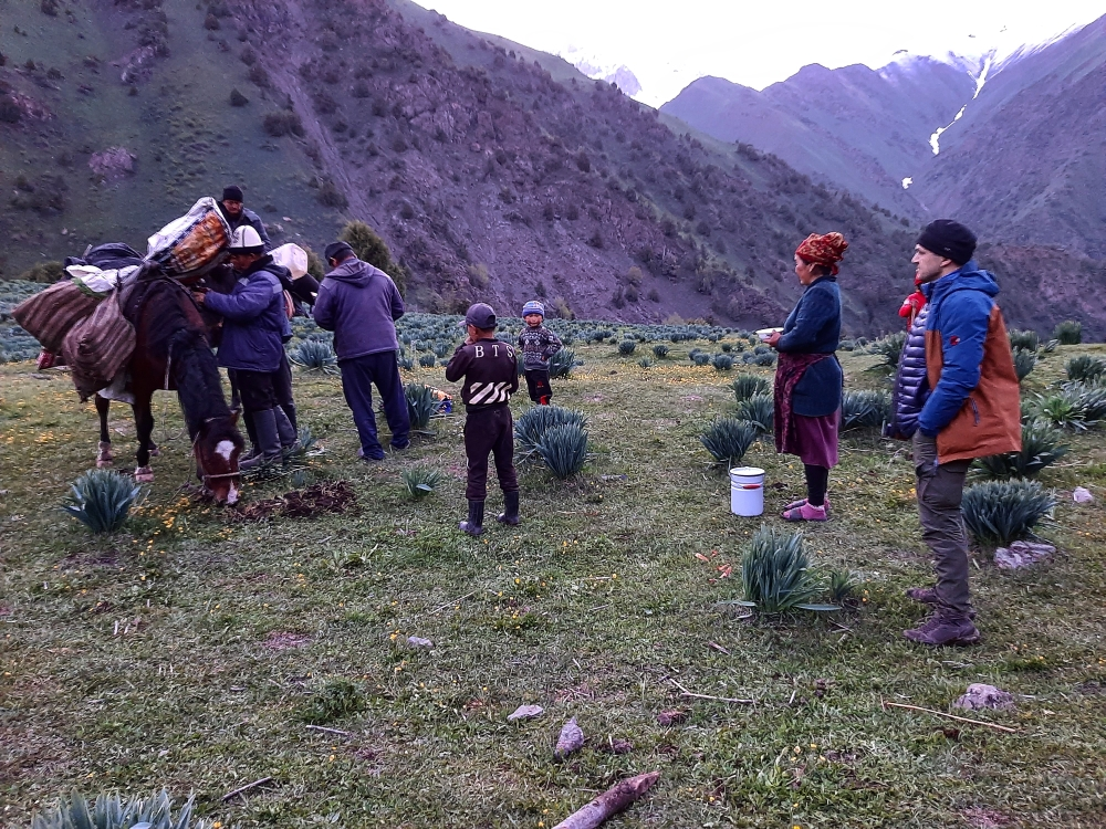 Traditional life of Kyrgyz Nomads. Welcoming  newcomers in the Konush ( Nomad camping)