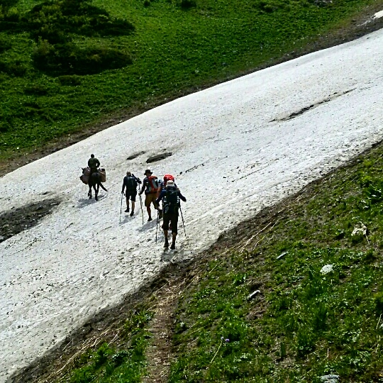 Crossing the snow path on the Trekking route in July