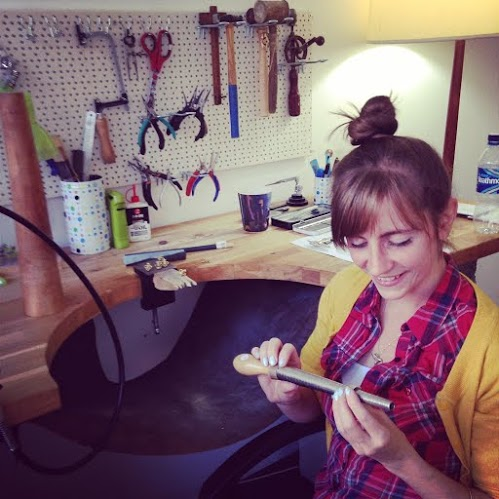 Picture of Emma Hedley sitting at her Jewellers Bench