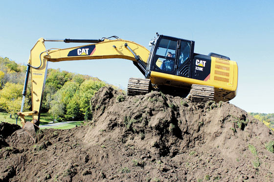 Bellevue's Dean Stoecken of J.J. Scheckel Heavy Equipment operates a 320 Cat Excavator to remove over 6,000 cubic feet of dirt to make room for a second ball field just west of Ensign Corp.