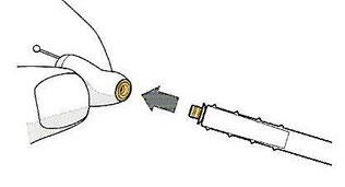 Mettre le nouveau pare cérumen sur l'appareil auditif