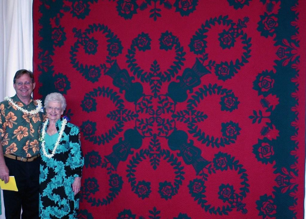 He Mala Pua Loke o ka Wahine Mo`i  (Ric with Mom, who keeps this quilt.)