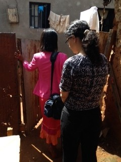 A home visit in a Kigali umudugudu ~ neighborhood