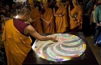Tibetan monks dismantling a sand mandala