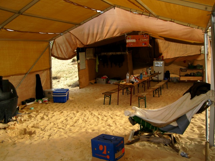The main tent in camp, with our water supply on the left: the black tank is filled with drinkable water.