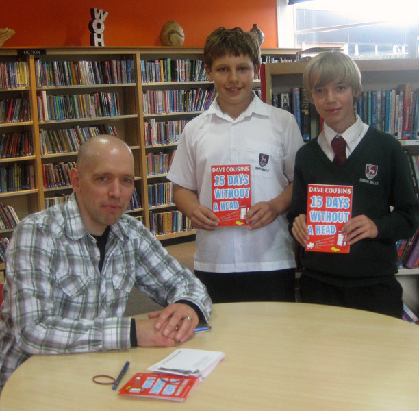 Signing books and postcards with Daniel and Nick at Simon Balle School
