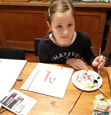 Johanna Datler malt ein Porträt nach einem Künstlerbild