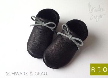 Mokassins in schwarz, Schleife grau, ab 40,90€