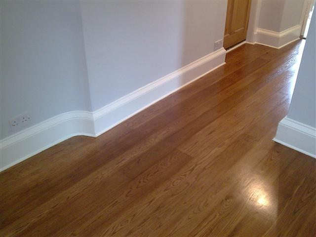 Ardoch House hallway - reclaimed oak, sanded stained and finished with Junckers HP Commercial