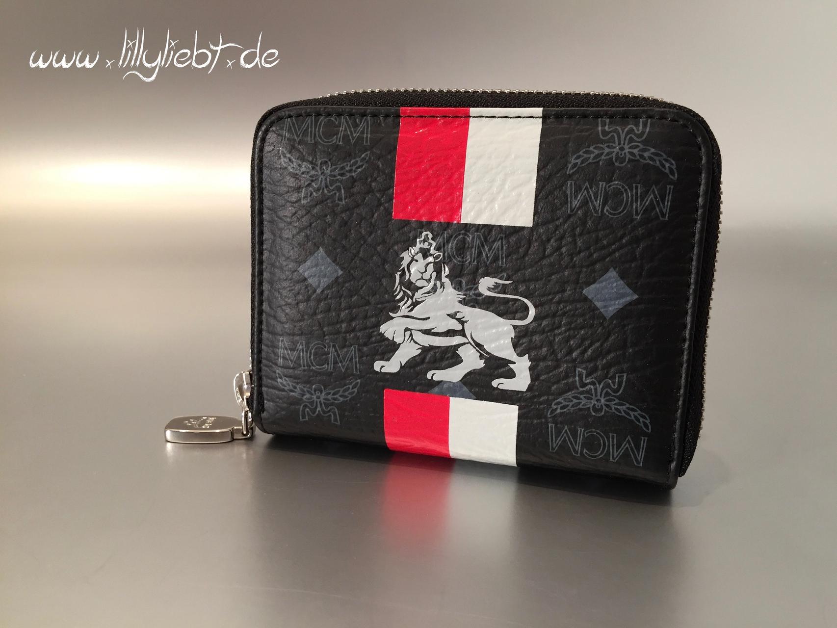 mcm munich lion compact zip wallet in schwarz ankauf verkauf second hand designertaschen. Black Bedroom Furniture Sets. Home Design Ideas
