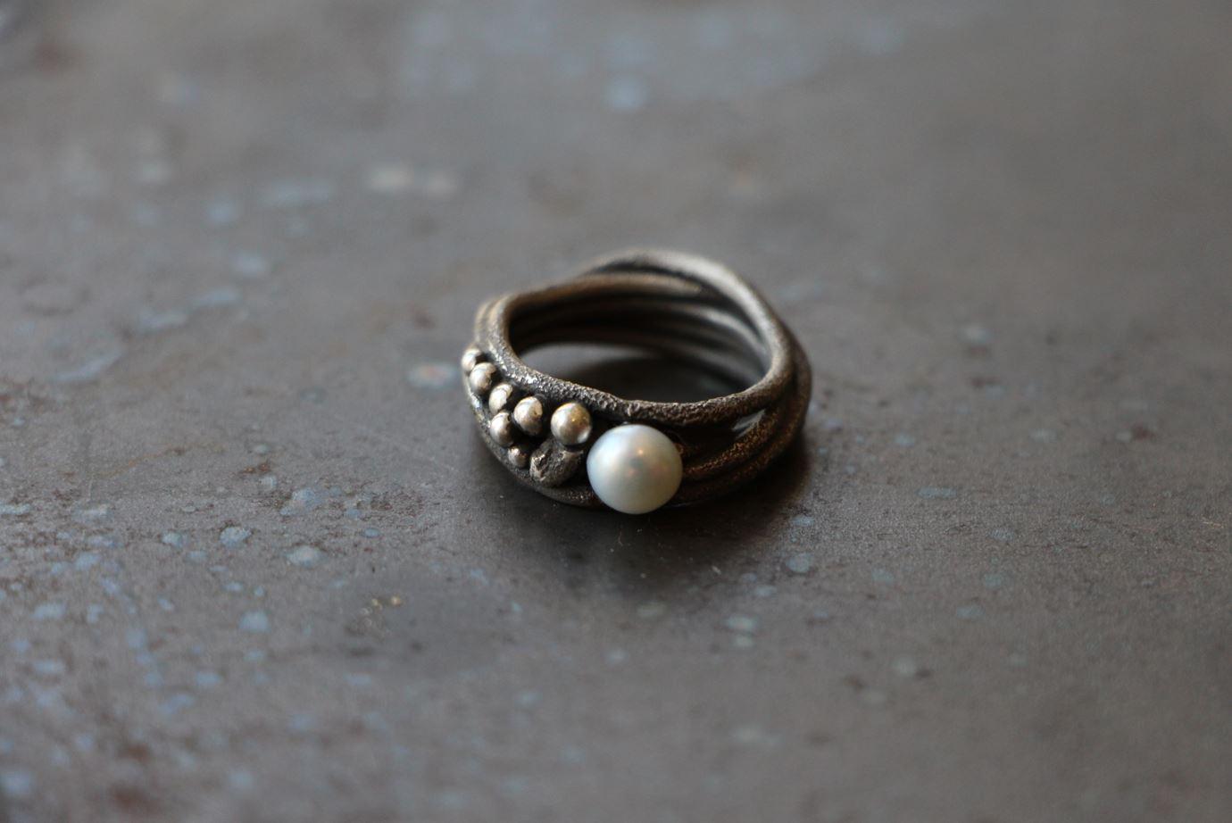 Seetang mit Perle