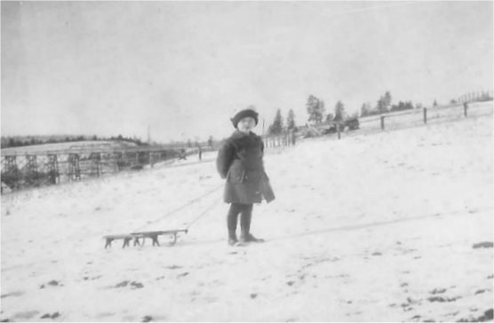 1918: Winter view of the bridge on Forker Road by the intersection with Moffat and Judkins (bridge built in 1905 and taken down in 1922). Sister Vivian Johnson