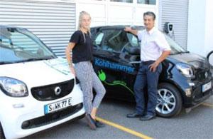 Mit den Elektro-Autos pendeln Mitarbeiter zwischen der Druckerei und dem Kohlhammer Verlag