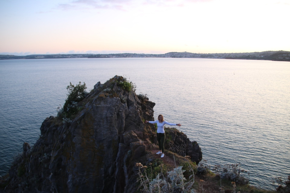 Me standing on the cliff door in Torquay