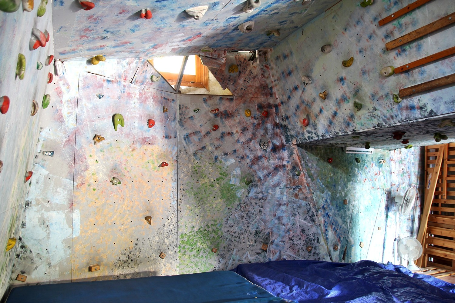The climbing wall in the garage
