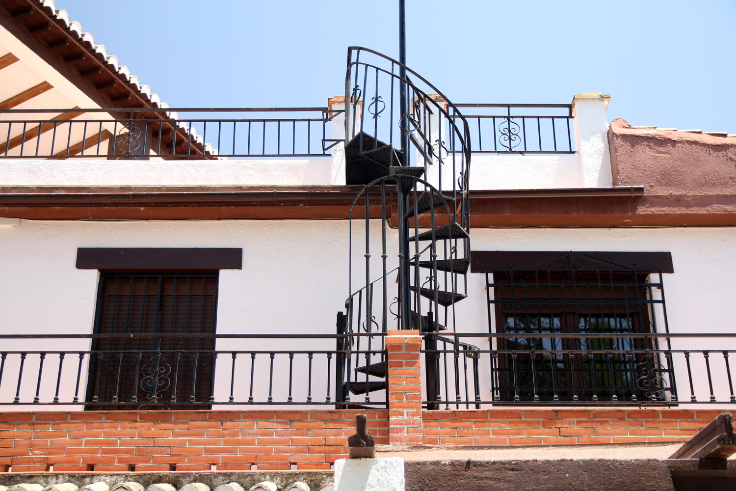 The winding staircase that leads to the roof terrace