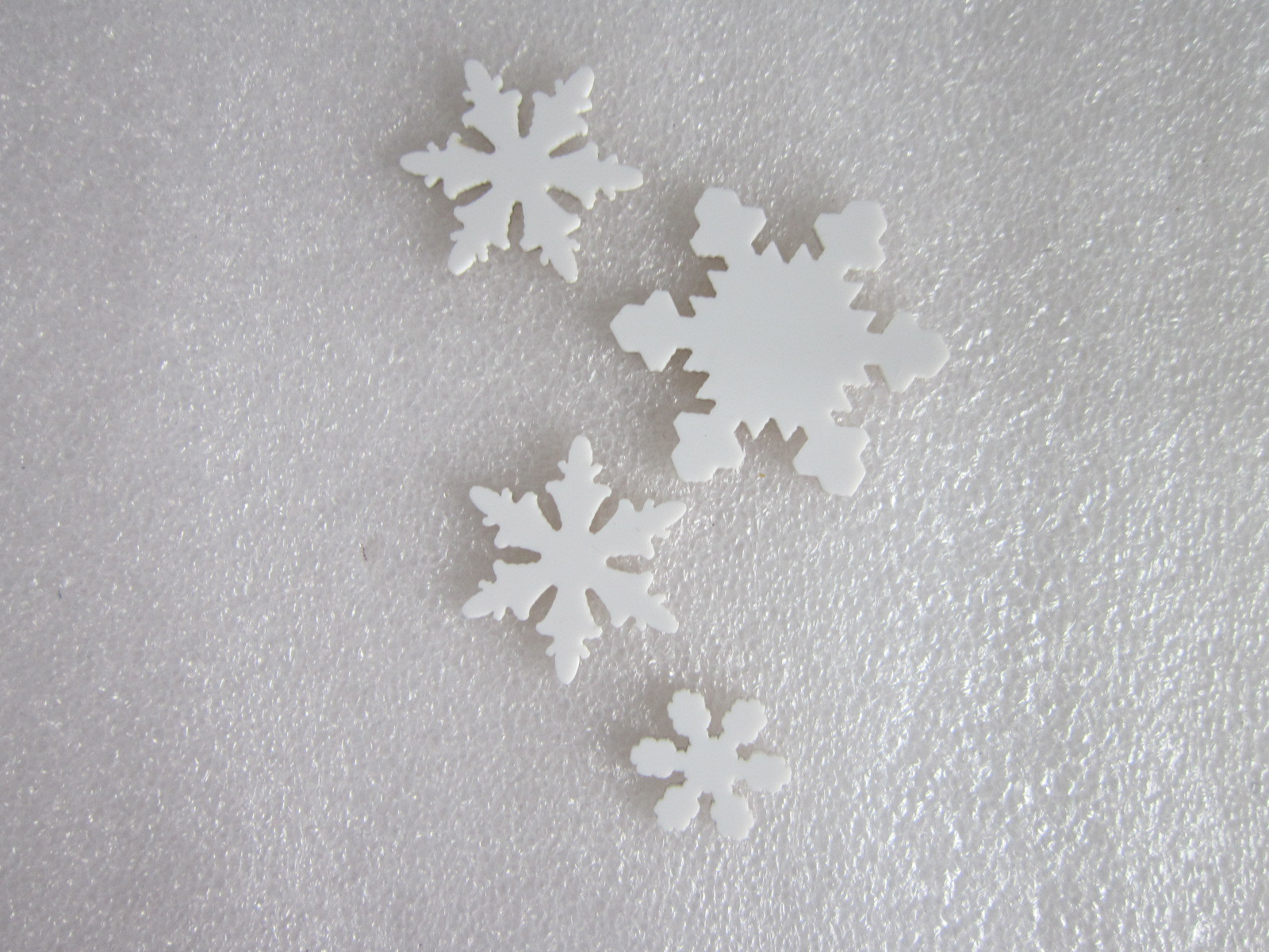 snowflakes laser cutting with white acrylic