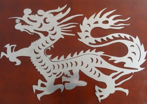 Laser cutting flat metal work of art